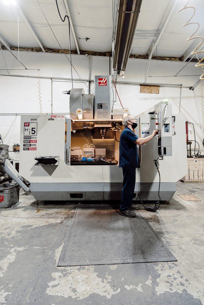 Ermak machine shop technician programming the Haas VF Series CNC vertical machining center