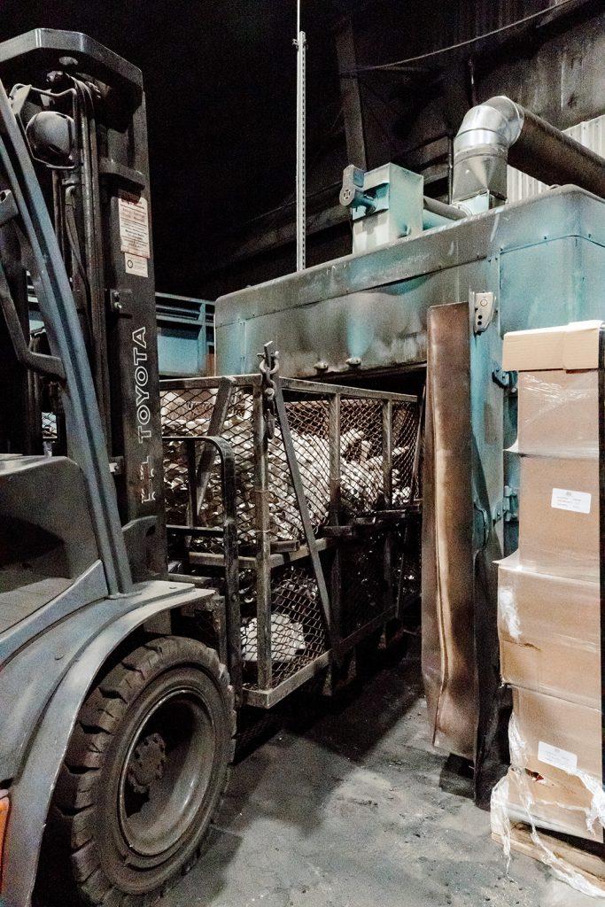 Moving parts into heat treat process