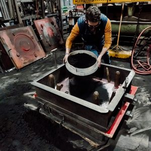 Filling the sand into the molds in the sand casting process